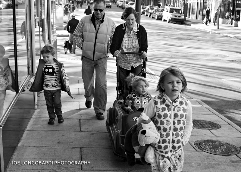 Family strolling down Patton Avenue in downtown Asheville, North Carolina