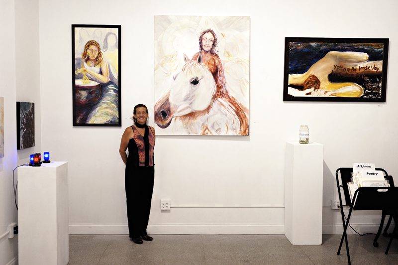 "Dawn Eareckson flanked by her paintings ""Drummer Girl"" and ""Nowness"""