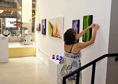 Lori hanging art.