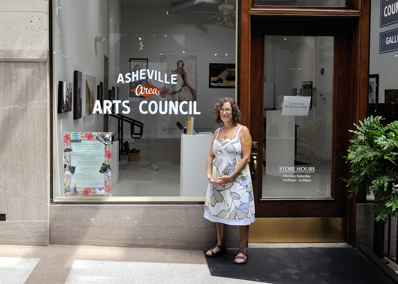Aurora Studio founder and Program Director Lori Greenberg at A Healing Light group art show at Asheville Area Arts Council.