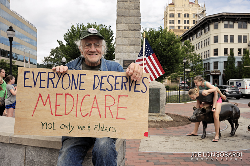 Everyone Deserves Medicare. Vance Monument, downtown Asheville, North Carolina, June 26 2017. Participating in the nationwide demonstration advocating for the approximately 23 million people who would lose health insurance coverage under the Senate healthcare bill. The proposed bill also cuts $800 billion from Medicaid.